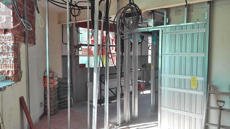 Puertas correderas empotradas al tabique sincro reformas for Construir puerta corredera