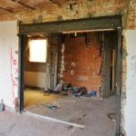 Bigues i pilars en una obertura de mur de càrrega reforma de pis