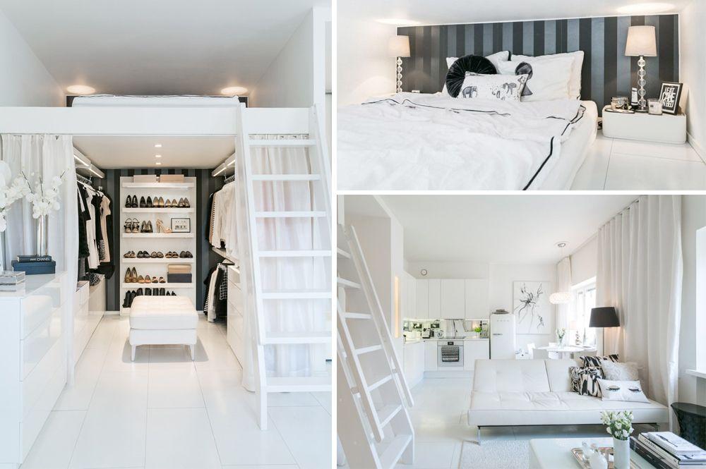 Estudi tipus loft amb altell amb llit dalt i el vestidor sota.