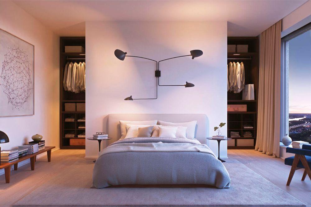 Vestidor darrere capçal de llit amb entrada a dos costats. Dormitori.