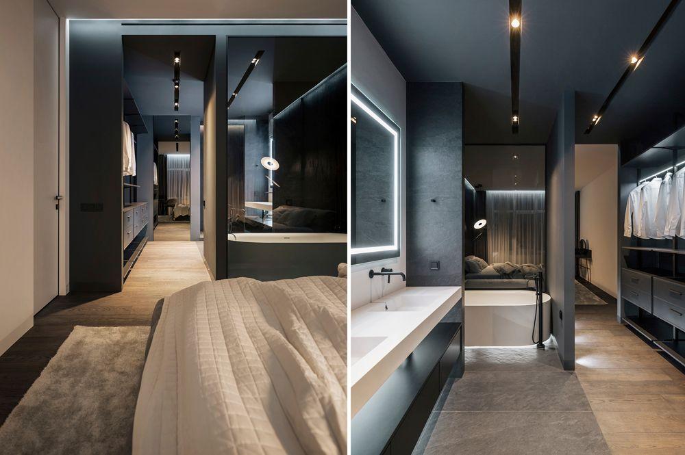 Dormitori modern amb el vestidor al bany.