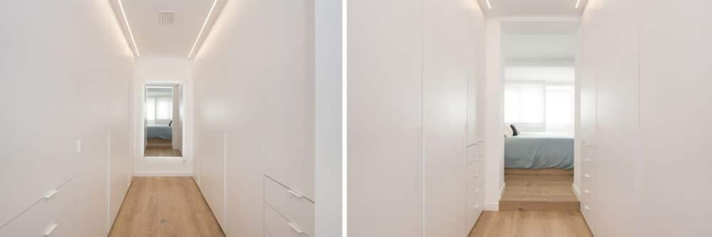 Vestidor integrat al dormitori. Distribuït en paral·lel i amb mirall.
