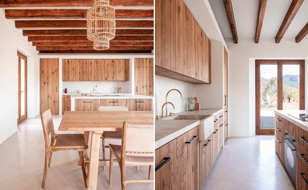Cocina comedor con estructuras y muebles de madera en una casa de decoración rústica
